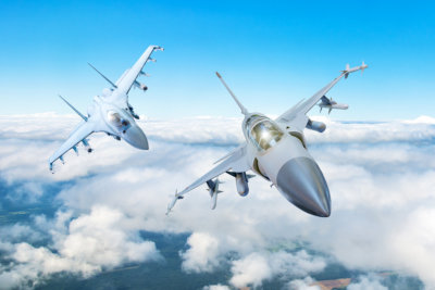 Pair of combat fighter jet on a military mission with weapons