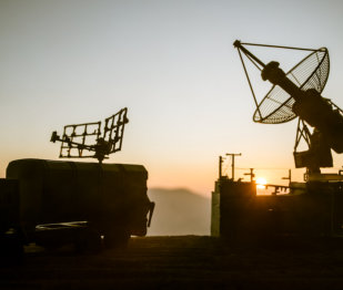 Silhouette of mobile air defence truck with radar antenna