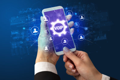 hand holding smartphone with VOIP abbreviation