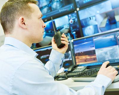 a man looking at the monitors