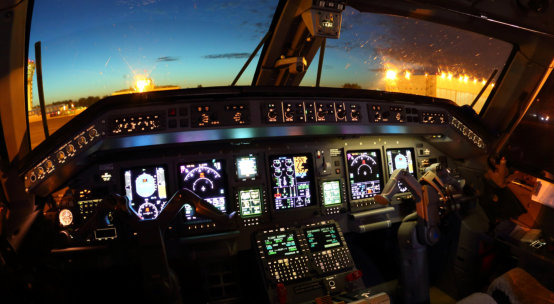 Cockpit of modern civil airplane at night.
